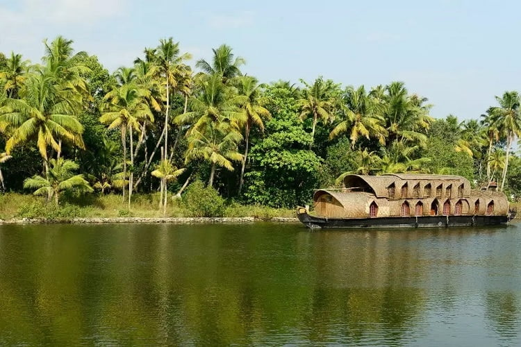 Kumarakom- Blue ocean, green mountain, and colorful birds make its tapestry